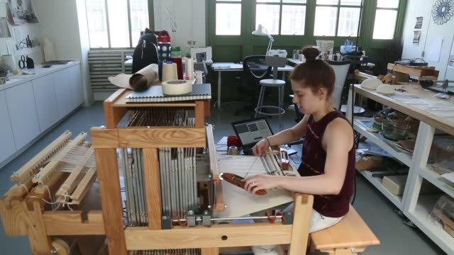 designers work on projects at the west elm makers studio in brooklyn us on tuesday july 7 2015 shots various shots of a female employee passing a... - loom stock videos & royalty-free footage