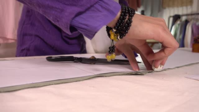 designing the style of clothes - パタンナー点の映像素材/bロール