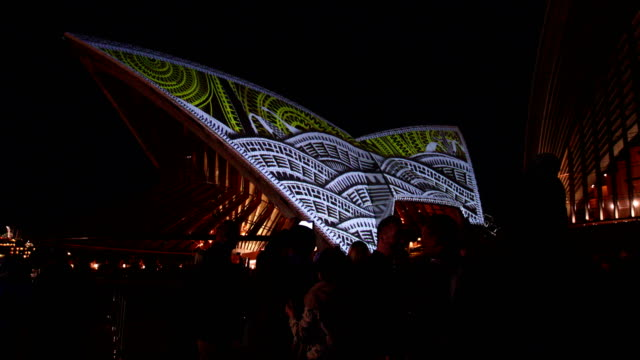 designs seen on the sails of the sydney opera house as part of the badu gili light installation on july 24 2018 in sydney australia this is the first... - installationskunst stock-videos und b-roll-filmmaterial