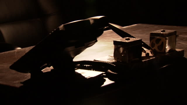 a desk in a dim office, tokyo, japan - autorität stock-videos und b-roll-filmmaterial