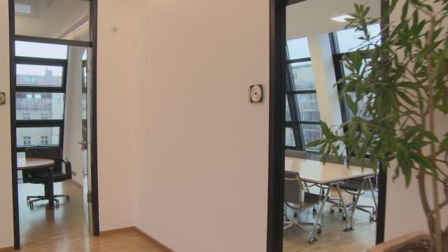 ts ms desk in empty, modern office / berlin, germany - office doorway stock videos & royalty-free footage