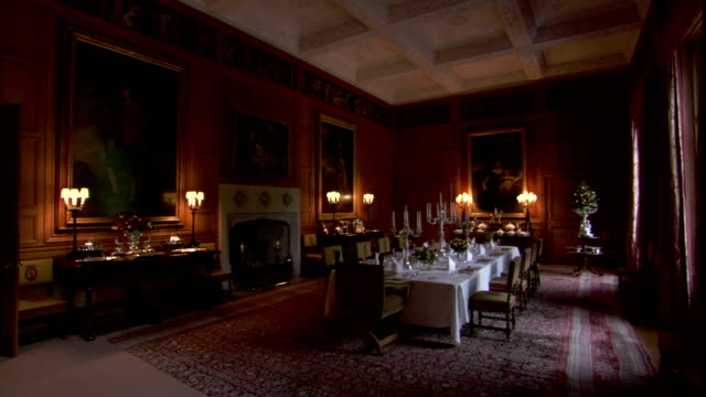 desk lamps illuminate a dining room in dunrobin castle. available in hd. - matrum bildbanksvideor och videomaterial från bakom kulisserna