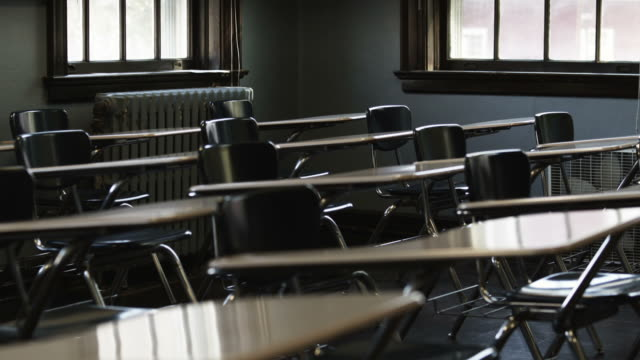 ms desks and chairs in empty classroom, buena vista, virginia, usa - klassenzimmer stock-videos und b-roll-filmmaterial