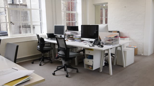 Deskspace with computers in modern office