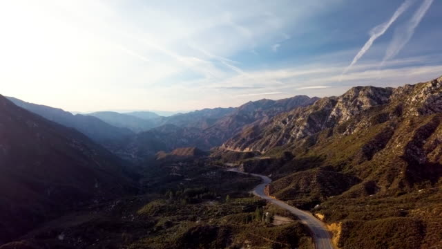desolate highway in angeles national forest - aerial drone clip - angeles national forest stock videos and b-roll footage