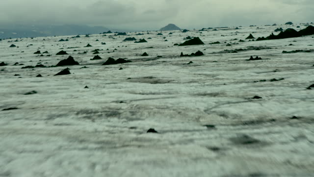 desolate volcanic icescape - terra brulla video stock e b–roll
