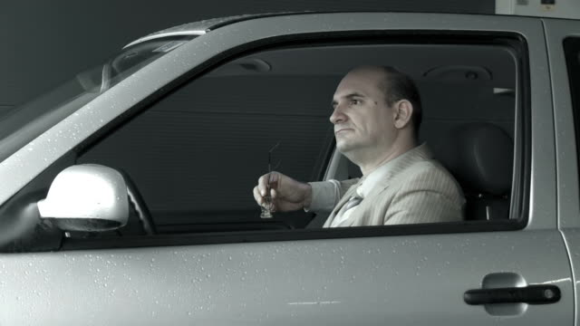 HD DOLLY: Despaired Man Sitting in the Car
