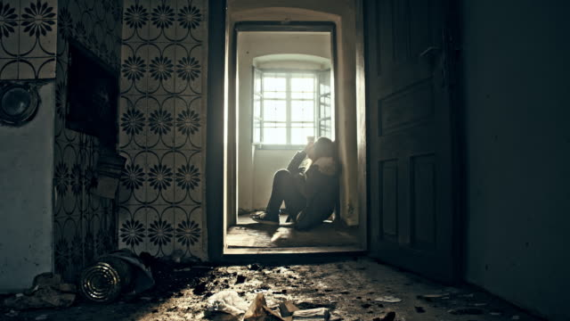 Despaired woman in an abandoned house