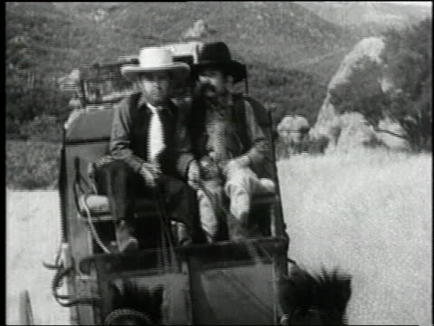 1938 MONTAGE desperadoes riding ponies and firing guns at a stagecoach in the film 'Terror of Tiny Town' / United States
