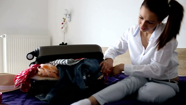 desperate girl has problem packing - full stock videos and b-roll footage