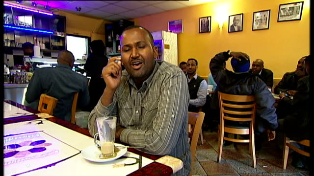 migration: channel 4 news reporter jamal osman's story: part 1; *uk rights only, no international use* england: london: clapham junction: ext general... - high street stock-videos und b-roll-filmmaterial