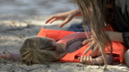 Desperate mom hugging little daughter in life vest, storm victims, catastrophe