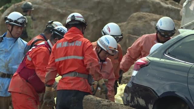 desperate relatives brace for bad news as rescuers dig through landslides in the wake of severe floods that have killed 100 people and left swathes... - soccorritore video stock e b–roll