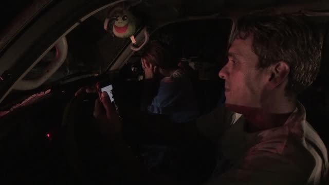 desperate venezuelans take to the roadside hoping to search for mobile signal in order to communicate with their loved ones in a pitch dark caracas... - authority stock videos & royalty-free footage