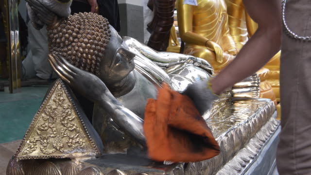 despite thai law prohibiting the export of buddha images that are bigger than 5' without first obtaining an export permit, many stalls and stores... - buddha stock videos & royalty-free footage