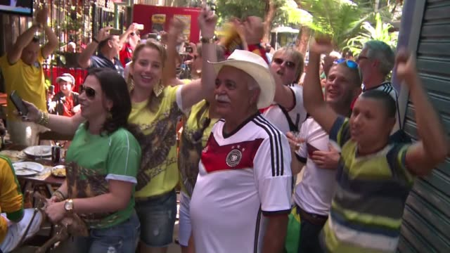 despite their humiliating 17 defeat at the hands of germany in the semi final brazilian fans would rather support joachim loews side than their long... - sportweltmeisterschaft stock-videos und b-roll-filmmaterial