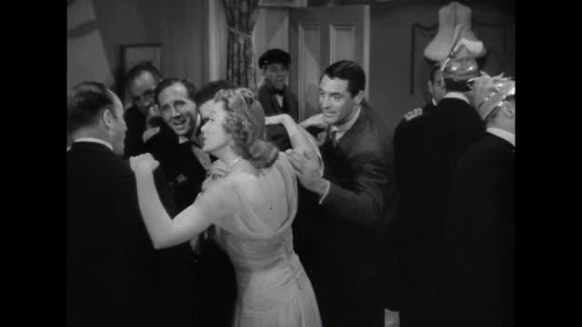 1941 Despite waiting for him the entire evening, woman (Irene Dunne) acts ambivalent about man's (Cary Grant) arrival