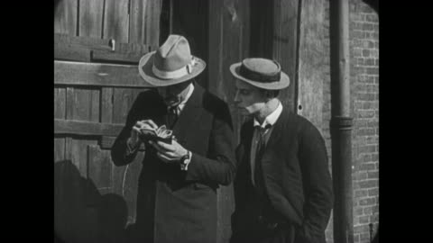 1921 despondent man (buster keaton) loses lucky horse shoe to passing man who happily finds wallet - luck stock videos & royalty-free footage