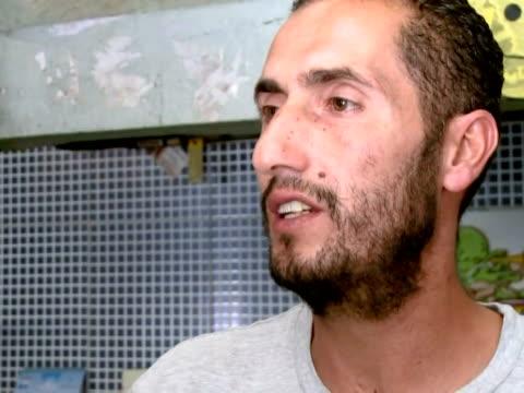 despues de siete meses de guerra civil los libios estan ansiosos por ver la vida volver a su ritmo habitual tripoli libya - guerra civil stock videos and b-roll footage