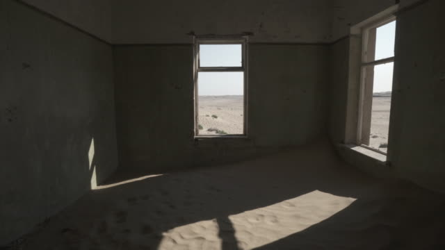 dessert against sky seen through window of abandoned house - kolmanskop, namibia - psychiatric hospital stock videos & royalty-free footage
