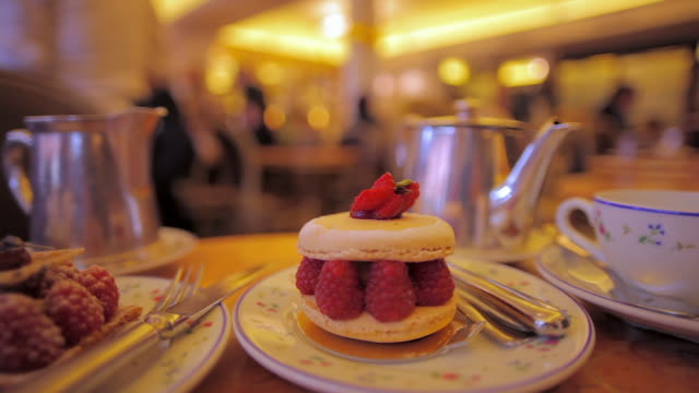 cu dessert and teapot in traditional parisian tea room, paris, france - frankrike bildbanksvideor och videomaterial från bakom kulisserna