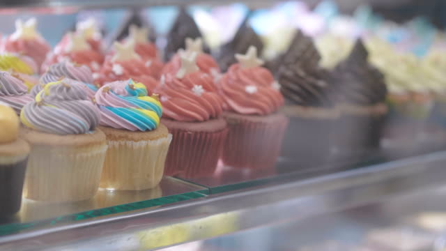 dessert topping handmade cup cakes - dessert topping stock videos & royalty-free footage