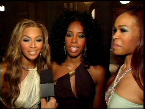 destiny's child thank roberto cavalli at the preview gala for the metropolitan museum's 'wild: fashion untamed' hosted by roberto cavalli hosts... - destiny's child stock-videos und b-roll-filmmaterial