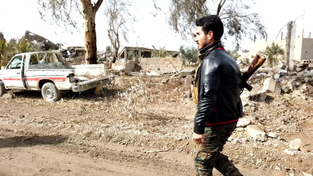 destroyed buildings and cars can be seen civilians have begun returning to some small towns close to bagouz that were recently liberated by the usled... - syrian democratic forces stock videos & royalty-free footage
