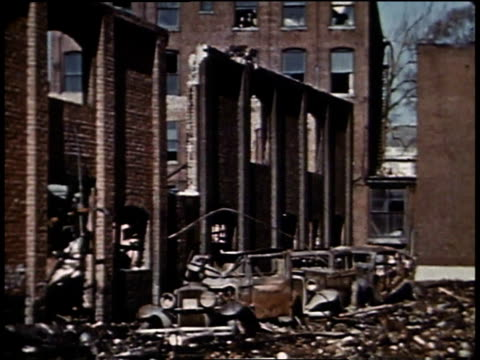 montage destroyed buildings and debris lining streets after a hurricane / new london connecticut united states - anno 1938 video stock e b–roll