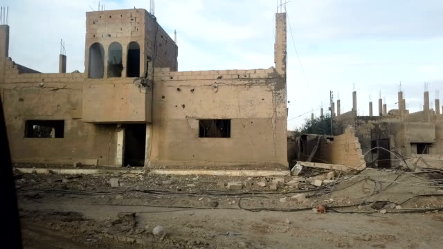 destroyed buildings on the outskirts of bagouz on february 10 2019 in bagouz syria usled coalition airstrikes continued across bagouz as the syrian... - syrian democratic forces stock videos & royalty-free footage
