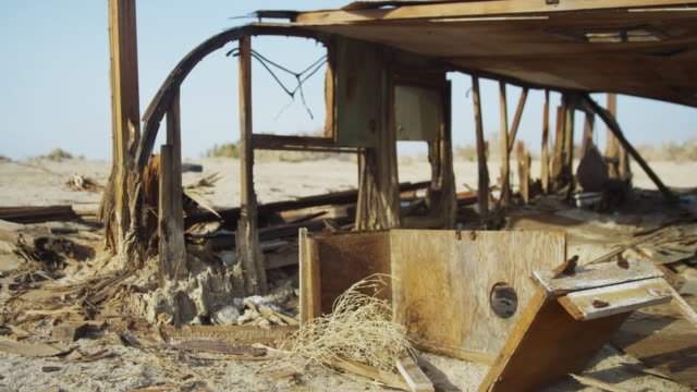 destroyed desert houses in california desert, pan left - imperfection stock videos & royalty-free footage