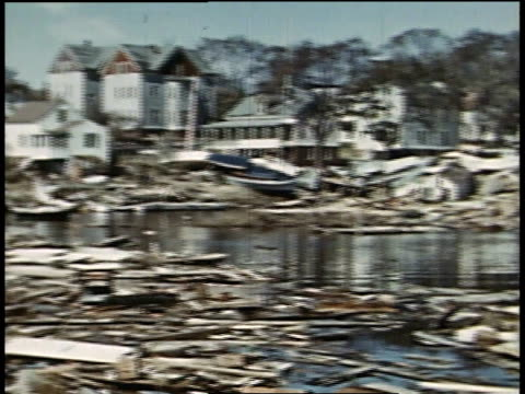 stockvideo's en b-roll-footage met montage destroyed homes and debris floating in water in the middle of a town after a hurricane / new london connecticut united states - 1938
