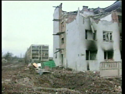 destroyed houses and bomb damaged streets riddled with craters and debris grozny; 18 feb 00 - grosny stock-videos und b-roll-filmmaterial