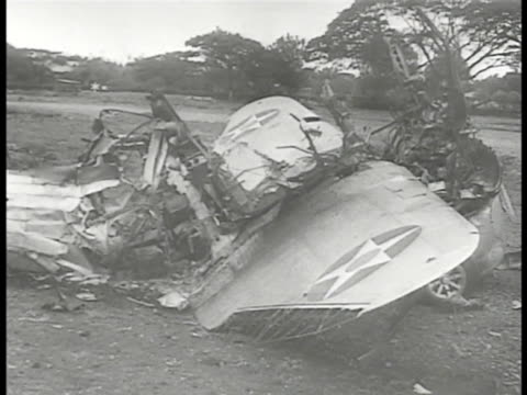 destroyed japanese aircraft in field pan to us aircraft parts on field cu national aircraft insignia star on plane part ha japanese troops walking ws... - isola di luzon video stock e b–roll