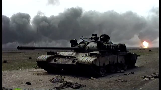 destroyed soviet made t-72 iraqi tank, burning oil wells behind it. - destruction stock videos & royalty-free footage