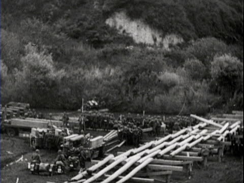 a destroyed tank soldiers crossing the river with the use of a pontoon bridge soldiers sleeping in their vehicle - pontoon bridge stock videos and b-roll footage
