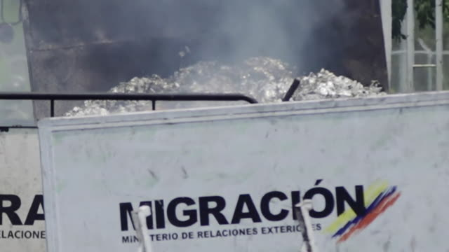 destroyed trucks from an aid convoy on the venezuelacolombia border after violent clashes between antigovernment protesters and venezuelan government... - maduro stock videos & royalty-free footage