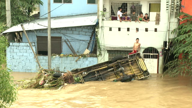 Destroyed Vehicle In Deadly Flood Waters In Manila Philippines