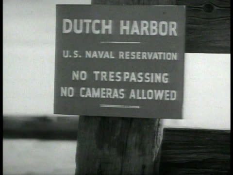 destroyer in harbor. sign: dutch harbor us naval reservation no trespassing no cameras. dutch harbor. vs us naval ships docked in harbor. unalaska... - no trespassing stock videos & royalty-free footage