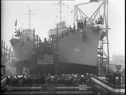stockvideo's en b-roll-footage met destroyer ship launched from a new jersey shipyard in front of a large crowd / uss fletcher launching out of the shipyard / women christens a ship... - recordbrekend
