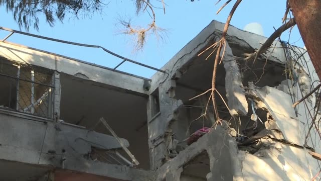 destruction after a rocket from gaza hit an apartment building in ashkelon killing one man and injuring several others during the night - ashkelon stock videos and b-roll footage