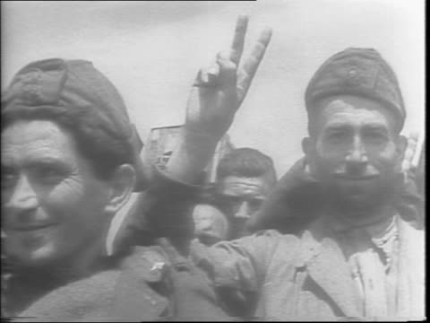destruction and debris from buildings bombed on the island of pantelleria / armed troops march around the island / italian prisoners smile and wave... - 1943 stock videos & royalty-free footage