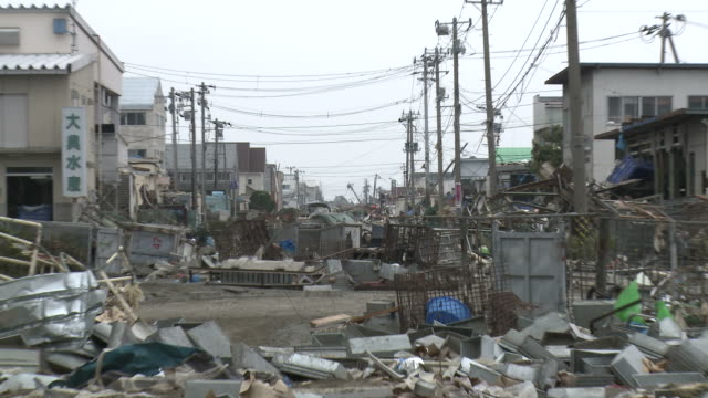 destruction caused by tsunami after magnitude 9 tohoku earthquake, north east japan, march 2011. zoom out of street completely filled with debris from tsunami in ishinomaki city,  miyagi prefecture - 2011 stock videos & royalty-free footage