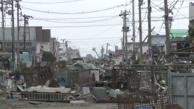 destruction caused by tsunami after magnitude 9 tohoku earthquake, north east japan, march 2011. close up of street completely filled with debris from tsunami - tsunami stock videos & royalty-free footage