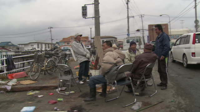 destruction caused by tsunami after magnitude 9 tohoku earthquake, north east japan, march 2011. drive past survivors sitting on street in ishinomaki after tsunami - 2011 stock videos & royalty-free footage
