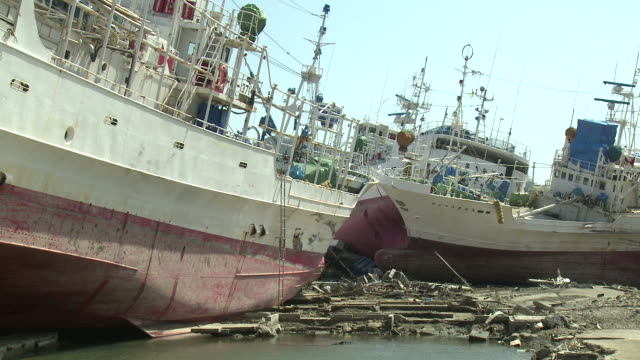 destruction in kesennuma city, a traditional fishing town in n e japan filmed on 1 april 2011, 3 weeks after a tsunami which was caused by magnitude 9 tohoku earthquake off north east japan / audio - abandoned stock videos & royalty-free footage