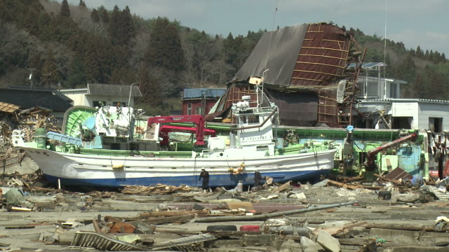 destruction in kesennuma city, a traditional fishing town in n e japan filmed on 1 april 2011, 3 weeks after a tsunami which was caused by magnitude 9 tohoku earthquake off north east japan / audio - recovery stock videos & royalty-free footage