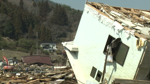 destruction in kesennuma city, a traditional fishing town in n e japan filmed on 1 april 2011, 3 weeks after a tsunami which was caused by magnitude 9 tohoku earthquake off north east japan / audio - rebuilding stock videos & royalty-free footage
