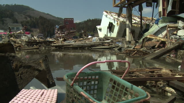 destruction in kesennuma city, a traditional fishing town in n e japan filmed on 1 april 2011, 3 weeks after a tsunami which was caused by magnitude 9 tohoku earthquake off north east japan / audio - tsunami stock videos and b-roll footage