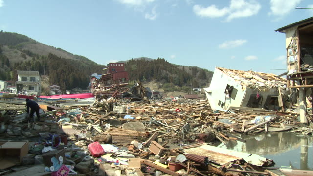destruction in kesennuma city, a traditional fishing town in n e japan filmed on 1 april 2011, 3 weeks after a tsunami which was caused by magnitude 9 tohoku earthquake off north east japan / audio - 犯罪点の映像素材/bロール
